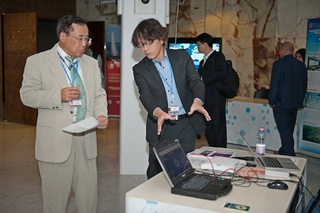 Mr Takeshi Kanazawa(right) from Panasonic demonstrates the cellular-based disaster recovery mobile network system