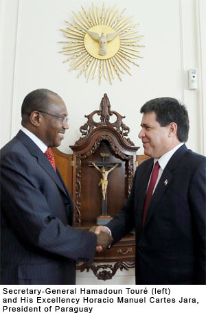 Secretary-General Hamadoun Touré (left) and His Excellency Horacio Manuel Cartes Jara, President of Paraguay